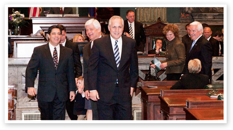 Senate Democratic Leader Jay Costa and Republican Leader Dominic Pileggi escort Jim Cawley from the Senate rostrum to the swearing-in of Gov. Tom Corbett.